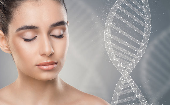 Pretty lady with closed eyes next to DNA chain