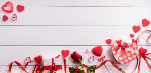 Valentine's day gift.Gift boxes and rose on white wooden table