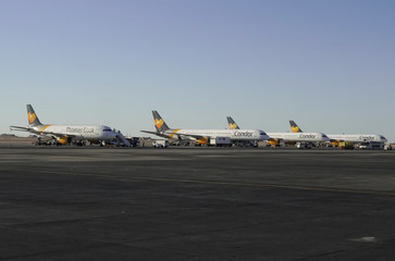 Passenger jets operated by Condor, a Thomas Cook subsidiary, are seen on the runway at Hurghada International Airport