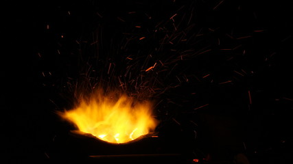 Aluminium Prints Grill / Barbecue Red hot sparks motion of fire night flying from flame