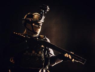 Shoulder portrait of army elite troops soldier, anti-terrorist tactical team wit shotgun, helmet...
