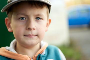 a aucasian sad boy, looking away