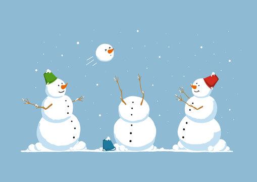 Funny snowmen playing snowballs