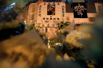 A picture of Chow Tsz-lok, 22, a university student who died two months ago after he fell from a car park during a protest, is seen on a makeshift memorial at Tseung Kwan O district in Hong Kong