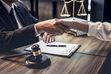Good service cooperation of Consultation between a male lawyer and business woman customer, Handshake after good deal agreement, Law and Legal concept