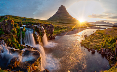 Beautiful landscape with sunrise on Kirkjufellsfoss waterfall and Kirkjufell mountain, Iceland,...