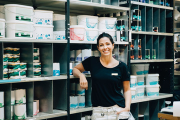Portrait of smiling sales woman standing in hardware store