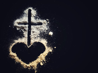 Lent Season,Holy Week and Good Friday concepts - Image of ash in shape of heart and cross on dark background