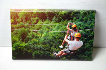 Canvas print on white table. Photo with gallery wrap method of canvas stretching on stretcher bar....