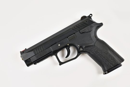 A semi-automatic pistol 9mm luger on a white background