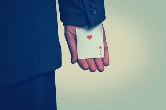 male hand hiding ace card in the sleeve