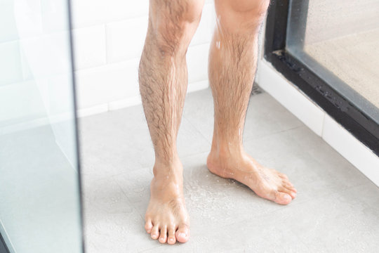 Close up man legs with taking a shower in the bathroom, health care