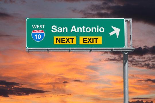 San Antonio Texas route 10 freeway next exit sign with sunset sky.