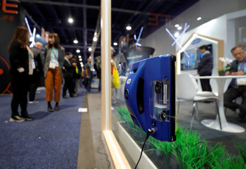 A Hobot 298, a window-cleaning robot with ultrasonic spray, cleans a window during the 2020 CES in Las Vegas