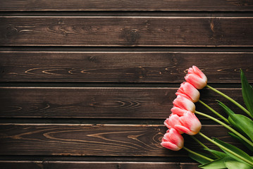 pink flowers tulips on wooden table for greeting card template