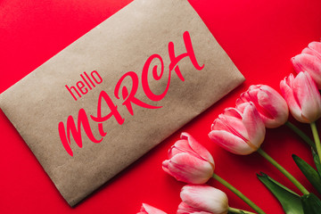 Greeting card with the inscription Hello March. Bouquet of pink Tulip flowers