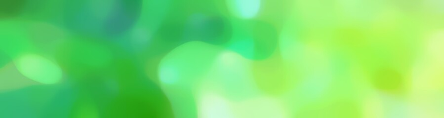 soft unfocused horizontal background graphic with medium sea green, pale green and light green colors space for text or image