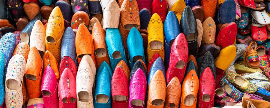 """Traditional vibrant Moroccan slippers - """"babouches"""" on the market in Fez, Morocco."""