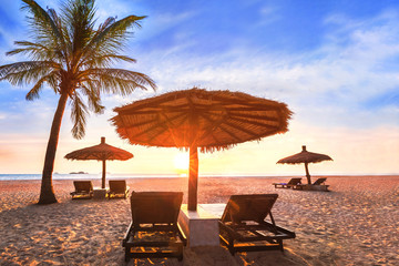 Tropical beach landscape at sunset, summer vacation holiday in paradise luxurious coastal hotel...
