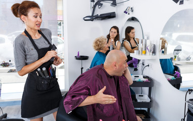 Shocked man in barber chair