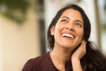 Confident Hispanic woman laughing and smiling stock photo