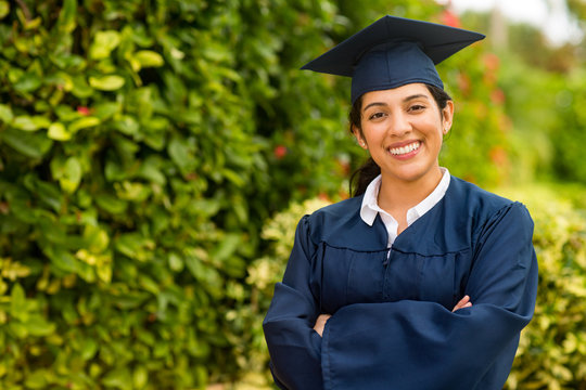Young hispanic female graduate at her graduation