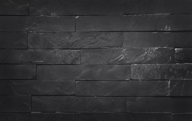 Dark grey black slate texture with high resolution, pattern of stone brick wall for background and...