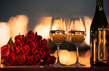 Romantic dinner date night with roses and wine.