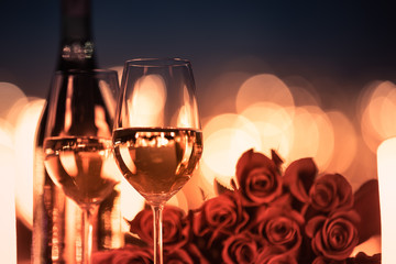 Wall Mural - Wine a roses in a candle light dinner setting,