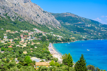 Barbati Beach with crystal clear azure water in beautiful landscape scenery - paradise coastline of...