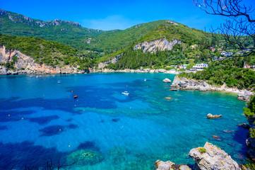 Fototapete - Paleokastritsa - Paradise coastline scenery with crystal clear azure water in Bay at white beach - Corfu, Ionian island, Greece, Europe