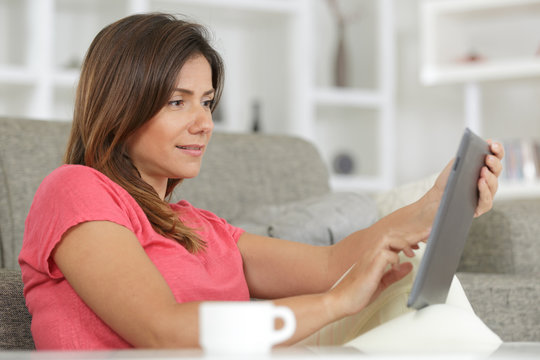 beautiful woman at home working with a tablet