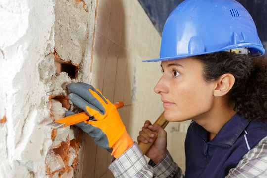 woman with hammer and chisel