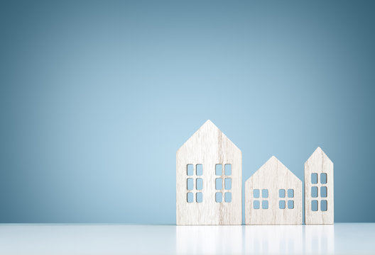 House real estate and construction background, wooden model houses