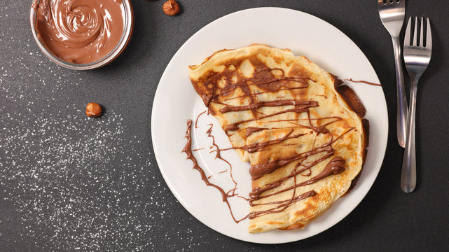 crepe with chocolate sauce in plate