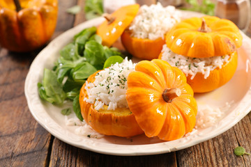 baked pumpkin with rice and salad