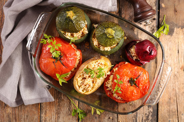 Photo sur Aluminium Fleur baked vegetable- tomato, zucchini and potato stuffed with cereal