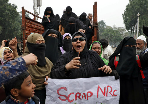 Demonstrators shout slogans as they gather to attend a sit-in protest against a new citizenship law, at Park Circus Maidan in Kolkata