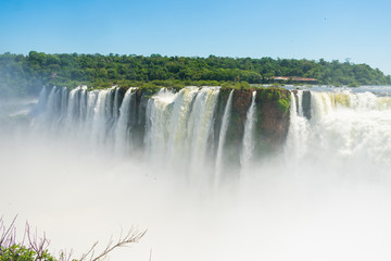 A view of the waterfalls throught the mist at the Iguazu National Park in Puerto Iguazu, Argentina