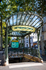 PARIS - September 6, 2019 : Abbesses subway station entrance designed by Hector Guimard at the Butte Montmartre