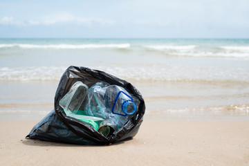 garbage bag on the beach.