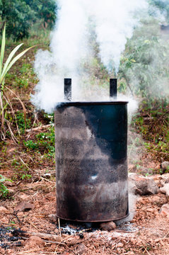 Burn charcoal by using an oil tank.