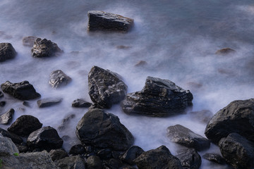 Volcanic rocks in Atlantic ocean, long exposure photography, San Juan de la Rambla coastline, Tenerife, Canary islands, Spain