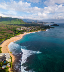 Wall Mural - Aerial view of the west coast of Oahu (lee shore) with surfers floating in the ocean at Makaha surf spot. Hawaii, USA