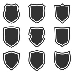 Shield shape icons set. Gray label signs. Symbol of protection