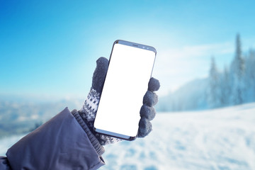 Phone in hand with glove. Concept of using mobile phone in winter, cold time. Isolated screen for mockup, app presentation