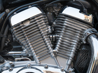 Closeup picture of chromed motorcycle engine on the street