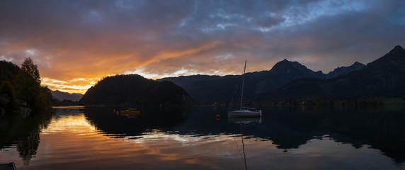 Peaceful autumn Alps mountain lake. Sunrise Wolfgangsee lake view, St. Wolfgang im Salzkammergut, Upper Austria.