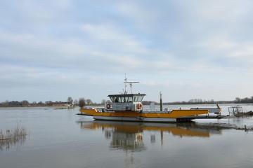 ferry waiting on flooded meadow near river IJssel