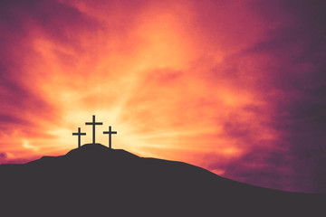 Three Easter Crosses on Hill of Calvary with Bright Shining Light and Clouds Texture Background